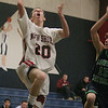 Middleton: Pat Wood from North Shore Tech goes up for a layup as Lowell Catholic's John Harlow leaps to defend the play during the second quarter of their teams' game in Middleton on Thursday. Wood scored 12 points to help the Tech to a 92-67 win. Photo by Matthew Viglianti/Staff Photographer Thursday, January 21, 2010.