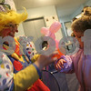 Beverly: Kare Deering, 2, from Salem holds out her arm as JuJuBee the Clown from Nottingham, NH places a balloon puppy on her wrist during Beverly's First Night celebration on Wednesday. Photo by Matthew Viglianti/Staff Photographer Wednesday, December 31, 2008.