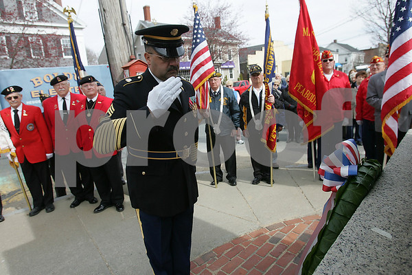 Peabody: John Silva from Peabody salutes a wreath he laid on the Lexington Monument in Peabody during a Patriots Day ceremony in the city on Monday. Silva is on active duty with the Massachusetts Army National Guard. Photo by Matthew Viglianti/Staff Photographer Monday, April 20, 2009.