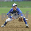 Peabody: Justin Massey stays low to field a ground ball at third base for the Swampscott Big Blue during their away game at Peabody on Wednesday. Peabody won the game 3-2 in extra innings. Photo by Matthew Viglianti/Staff Photographer Wednesday, May 6, 2009.