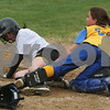 Peabody: Amy Pelletier from Bishop Fenwick slides in safely to home ahead of a tag from East Boston catcher Brianna Bertoncini in the second inning for the Crusaders' fifth run during their game against East Boston in Peabody on Sunday. Photo by Matthew Viglianti/Staff Photographer Sunday, May 17, 2009.