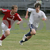 Hamilton: Masconomet junior forward John Miller, left, and Hamilton-Wenham junior defender Brian Ford eye a loose ball during their teams' game in Hamilton on Tuesday. Masconomet won the game 2-1. Photo by Matt Viglianti/Salem News Tuesday, September 16, 2008