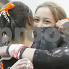 Beverly: Megan Harty, a sophomore at Beverly High School, right, gets a hug from a teammate after her routine on the uneven bars during the Panthers' meet against Marblehead in Beverly on Thursday. Photo by Matt Viglianti/Salem News Thursday, January 08, 2009