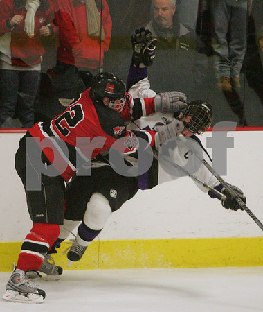 Woburn: Marblehead #22, left, lays a hit on Shawsheen Valley senior captain Michael Derosa during the second period of the Headers' state tournament game against Shawsheen Valley in Woburn on Tuesday. Photo by Matthew Viglianti/Staff Photographer Tuesday, March 3, 2009.