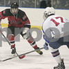 Salem: Marblehead sophomore Ryan Dempsey, left, moves the puck into the Swampscott zone as Swampscott senior Sam Rakoc moves in to apply defensive pressure during the second period of their teams' state tournament game in Salem on Sunday. Photo by Matthew Viglianti/Staff Photographer Sunday, March 1, 2009.