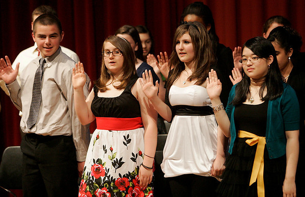 Salem: Eight grade students from Collins Middle School in Salem take an oath during an ceremony inducting them in the National Junior Honor Society on Thursday. Photo by Matthew Viglianti/Staff Photographer Thursday, June 3, 2010.