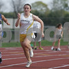 Peabody: Brittany Dolan, a sophomore at Bishop Fenwick High School, center, races in the 100 meter dash during Fenwick's home meet against St. Mary's of Lynn and Cathedral High Schools in Peabody on Tuesday. Dolan finished second in the race, ahead of Emma Levangia, a sophomore from St. Mary's of Lynn, left, and Amanda Bonny, a junior from Cathedral, right. Photo by Matthew Viglianti/Staff Photographer Tuesday, April 28, 2009.