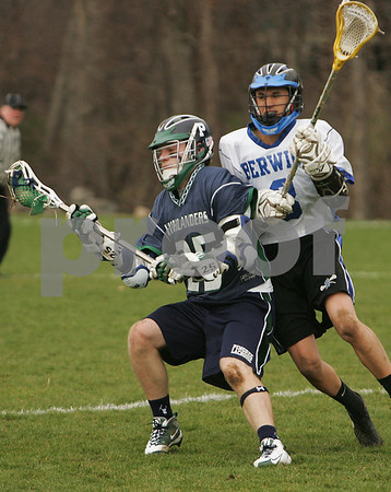 Hamilton: Jack Williamson from Pingree, left, uses his body to shield the ball from Phill Ramuno from Berwick Academy during the Highlanders' home lacrosse game against Berwick Academy on Tuesday afternoon. Photo by Matthew Viglianti/Staff Photographer Tuesday, April 7, 2009.