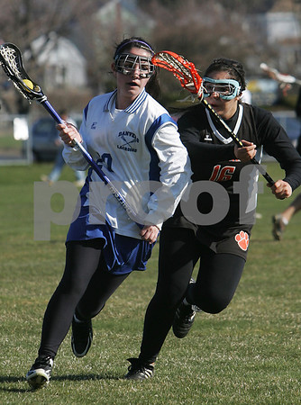Danvers: Katharine Jennings from Danvers, left, tries to turn the corner against Beverly senior Katina Pappas during the Falcons' home game against Beverly on Thursday afternoon. Photo by Matthew Viglianti/Staff Photographer Thursday, April 16, 2009.