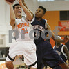 Beverly: Beverly junior guard Curtis Manuel, left, hangs in the air while attempting a first quarter lay-up while under defensive pressure from Greg Young of Minuteman during the Panthers' home game on Sunday. Photo by Matthew Viglianti Sunday, February 8, 2009.