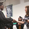 Beverly: Michael Clayton receives his diploma from School Committee President Annemarie Cesa during graduation ceremonies for the Beverly High School class of 2010 on Sunday. Photo by Matthew Viglianti/Staff Photographer Sunday, June 13, 2010.