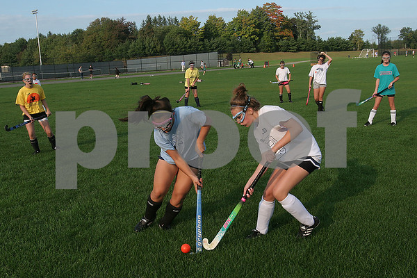 Peabody: Colleen Chu, left, and Rachel Seriti fight for the ball during practice with the freshman field hockey team at Bishop Fenwick High School on Tuesday afternoon. Photo by Matthew Viglianti/Staff Photographer. Tuesday, September 29, 2008.