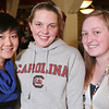Saugus: From left to right, Mengyue Zhang from China, Caroline Akerlund from Sweden, and Susanna Sihvonen from Finland pose during a holiday party for local au pairs at Prince PIzza in Saugus on Wednesday night. Photo by Matthew Viglianti/Staff Photographer Wednesday, December 16, 2009.