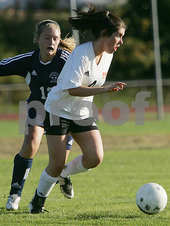 Beverly: Beverly junior Bridget Leahy, right, looks for an option after getting past Swampscott junior Robin Herlihy during the first half of their team's game in Beverly on Tuesday. Swampscott won the game 5-2. Photo by Matt Viglianti/Salem News Tuesday, October 07, 2008
