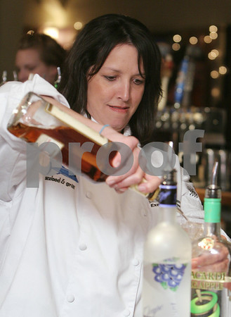 Salem: Salem Mayor Kim Driscoll makes a drink while tending bar at Finz Restaurant in Salem on Wednesday night. Mayor Driscoll and Representative John Keenan tended bar for the night, and all the tips they made, along with half the proceeds from the sales of their drinks, will be donated to Help for Abused Women and Children. Photo by Matt Viglianti/Salem News Wednesday, February 11, 2009