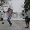 Beverly: Austrid Swensen, 11, of Beverly, left, moves to trap a pass from her friend Elizabeth Musumeci, 12, while playing soccer on Ocean Street in Beverly on Monday. Photo by Matthew Viglianti/Staff Photographer Monday, March 30, 2009.