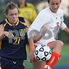 Salem: Salem State senior Kasey Hanson, right, plays the ball while under pressure from UMass Dartmouth sophomore Michaela Blackham during Salem State's home game against UMass Dartmouth on Tuesday. Photo by Matt Viglianti/Salem News Tuesday, September 16, 2008