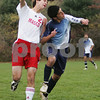Topsfield: Masconomet junior Nate Webster, left, wins a header over Swampscott junior Kyle Taylor during the second half of Masconomet's 2-0 win over the Big Blue in their Division 2 North quarterfinal game in Topsfield on Tuesday. Photo by Matt Viglianti/Salem News Tuesday, November 11, 2008