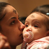 Salem: Elisa Nunez holds her niece, Jeiliany Perez (1), both from Salem, during an evening service at Immaculate Conception Parish in Salem on Ash Wednesday. Photo by Matthew Viglianti/Staff Photographer Wednesday, February 17, 2010.<br /> <br /> Also, Elisa Nunez holds her niece, Jeiliany Perez (1), both from Salem, during the service.