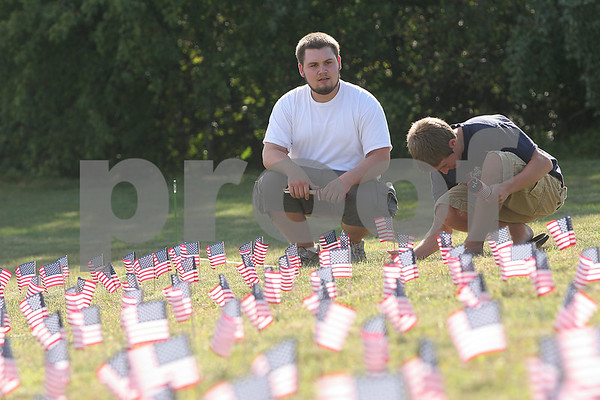 Boxford: Masconomet juniors Cole O'Malley, left, and Nate Hooper help their friend Olivia O'Malley place 3,000 American flags in the lawn outside the high school in rememberance of the victims of 9/11/01 on Wednesday afternoon. Photo by Matt Viglianti/Salem News Wednesday, September 10, 2008