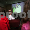 Beverly: Liz Flaherty, 13, from Beverly looks over her shoulder to talk to Sarah Goss, 14, from Beverly, left, and Raven Popek, 12, from Beverly, while watching an anime show called Fruits Basket with the anime club at the Beverly Public Library on Tuesday. The club began meeting monthly in September, and plans to meet every third Tuesday of the month until at least May. Photo by Matt Viglianti/Salem News Tuesday, December 16, 2008