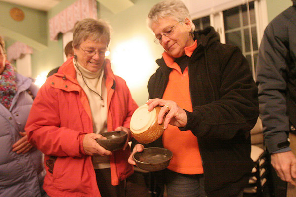 Danvers: Gail Arnold, left, and Fran Weil, both from Danves, take a look at some of the bowls available at the Empty Bowls Dinner Party at St. John's Prep in Danvers on Thursday evening. The event began in 1999 as a way of inspiring social change through art, and has raised money for Haven for Hunger in Peabody. Photo by Matthew Viglianti/Staff Photographer Thursday, January 14, 2010.