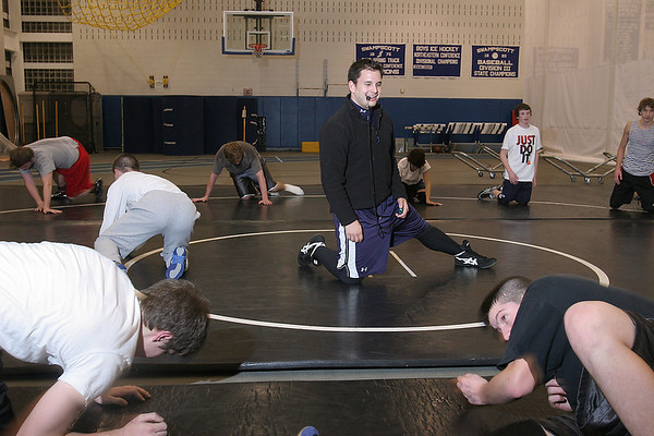 Swampscott: Mike Stamison supervises his team during a Marblehead/Swampscott wrestling team practice on Thursday. Photo by Matthew Viglianti/Staff Photographer Thursday, January 7, 2010.