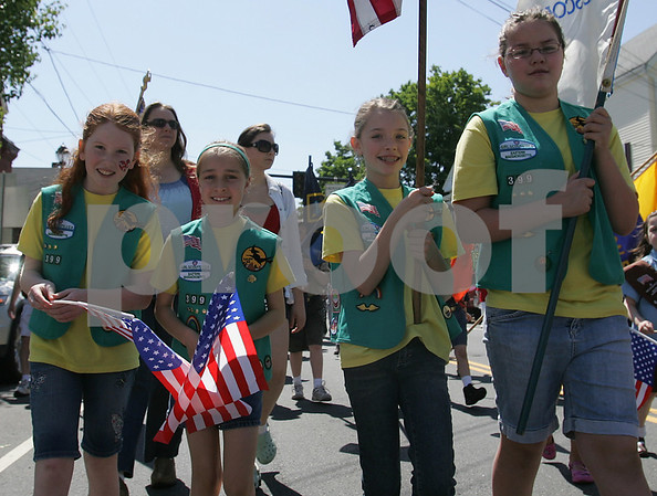 Salem: Members of the Salem Troop 339 Junior Girl Scouts wave American flags as they walk up North Street in Salem during a Memorial Day Parade on Monday morning. From left to right are Sophia Blake, Laura Barnes, Alex Szczechowicz, and Brianna Swan. Photo by Matthew Viglianti/Staff Photographer Monday, May 25, 2009.