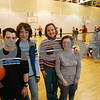 Peabody: Rosemary Piaker, center left, and her friend Chris Neenan, center right, both from Peabody, pose with their children, James Piaker and Becky Neenan, as a group of kids with special needs enjoy an evening of fun and exercise in the Carroll School gymnasium in Peabody on Monday. Piaker and Neenan are retiring this year as longtime leaders of the Peabody Parents of Children with Special Needs. Photo by Matt Viglianti/Salem News Monday, January 12, 2009
