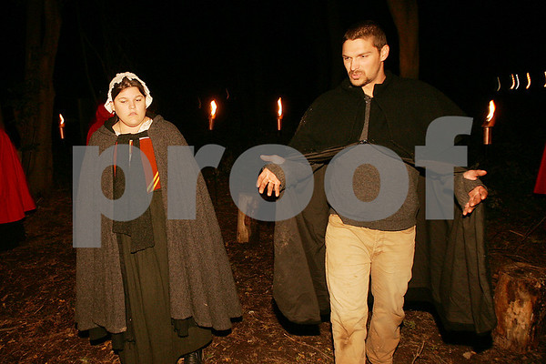 """Salem: Nicole Amero of Peabody and Benjamin Moulton of Beverly rehearse a scene from """"Terror Fantasies"""" within a ring of torches at Pioneer Village in Salem. History Alive! presents the play, which brings visitors through a terrifying night-time journey through Pioneer Village during the time of the infamous """"afflicted girls of Salem"""" from the late 1600s. Photo by Matt Viglianti/Salem News Tuesday, October 07, 2008"""