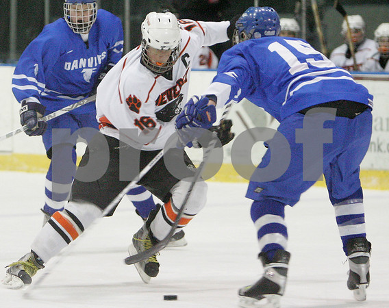 Salem: Beverly junior captain Jack Liacos (16) makes a move against Danvers senior defenseman Tim Wilkinson during the second period of the Panthers' home game against Danvers in Salem on Wednesday. Photo by Matt Viglianti/Salem News Wednesday, February 04, 2009