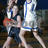 Danvers: Kiki McKenna from Beverly works to get out of a defensive trap by Danvers senior captain Erica Veilleux, left, and sophomore Kellie Macdonald, right, during the second period of their teams' game in Danvers on Tuesday. Photo by Matthew Viglianti/Staff Photographer Tuesday, January 13, 2009.