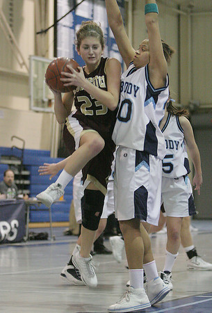 Peabody: Heather Cain from Gloucester, left, goes up strong to the basket against Peabody defender Janelle Rodriguez during the second quarter of their teams' game at the Peabody High School field house on Thursday night. Photo by Matthew Viglianti/Staff Photographer Thursday, January 28, 2010.
