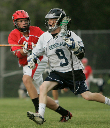 Hamilton: Colin McKenzie, right, rushes the ball up the field for Hamilton-Wenham as Garrett Glavin gives chase for Tyngsborough during their team's state tournament game in Hamilton on Wednesday. Hamilton-Wenham won the game 18-11. Photo by Matthew Viglianti/Staff Photographer Wednesday, June 3, 2010.