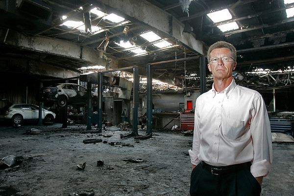 Beverly: Dennis Britton, owner of North Shore Volkswagen on Park Street in Beverly, stands inside his dealership's burnt-out repair shop on Wednesday afternoon. An early morning fire almost completely destroyed the dealership on Saturday, and fire officials suspect arson. A $5,000 reward has been issued for information. Photo by Matthew Viglianti/Staff Photographer Wednesday, June 2, 2010.