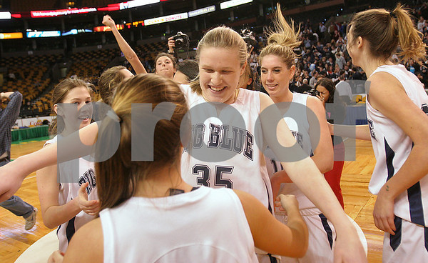 Boston: Swampscott freshman Caroline Murphy reaches to hug sophomore Lisa Gambale at center court while celebrating the Big Blue's 67-51 win over Archbishop Williams in the Division 3 state tournament semifinal at the TD Banknorth Garden in Boston on Monday. Swampscott advances to the Division 3 title game at the DCU Center in Worcester on Saturday. Photo by Matthew Viglianti/Staff Photographer Monday, March 9, 2009.