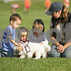 Beverly: From left, J.P. Murphy from Danvers, 3, Gabriel Bennett from Salem, 2, J.P.'s sister Haley Murphy, 5, and Katie Melin from Salem, pet Gidget, a 4-month-old Coton de Tulear puppy owned by Mary Margaret Kiley from Beverly, on the sidelines of the Beverly High School girls varsity soccer game against Salem in Beverly on Wednesday. Photo by Matt Viglianti/Salem News Wednesday, September 17, 2008