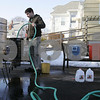 Salem: Salem native, Adam Walsh, brews a Czech pilsner in the driveway of long-time friend Chris Polakiewicz of Salem on a recent Monday afternoon. Walsh works in the Harpoon Brewery in Boston, and has been brewing beer as a hobby for several years. Photo by Matthew Viglianti/Staff Photographer Monday, February 9, 2009.