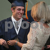 Danveres: Michael Carroll receives his diploma, and a hug, from his mother, Cathy Carroll, who works in the Benjamin Hall main office at St. John's Prep, during the the confering of diplomas at St. John's Prep's graduation ceremonies on Sunday morning. Sunday marked the 99th graduation ceremony at St. John's Prep. Photo by Matthew Viglianti/Staff Photographer Sunday, May 17, 2009.