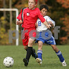 Peabody: Steven Heintzelman from the U-12 Middleton Snipers, left, fends off a challenge from Marty Michelman from the U-12 Peabody Bombers during the first half of their teams' championship game during the 18th annual Peabody Youth Soccer Columbus Day Tournament on Monday. Photo by Matt Viglianti/Salem News Monday, October 13, 2008
