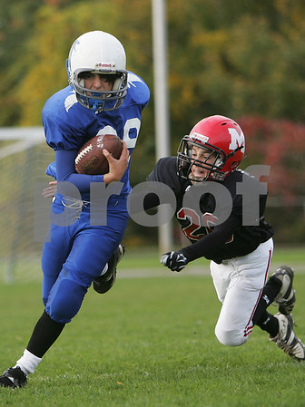 Marblehead: Alex Valles from Danvers, left, shakes off a diving tackle by Marblehead's Charlie Thompson during the Marblehead youth football team's 22-8 win over Danvers on Sunday afternoon. Photo by Matt Viglianti/Salem News Sunday, October 19, 2008