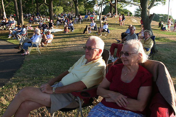 Salem: Jerry and Joanne Judge from Salem enjoy the music played by the North Shore Concert Band at Salem Willows on Tuesday night. Hundreds of people parked chairs and blankets on the ocean-front lawn to listen to the musical program and enjoy the sun's fading rays. Photo by Matthew Viglianti/Staff Photographer Tuesday, July 27, 2010.