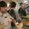 Danvers: Joe Moccia, a senior at St. John's Prep from Nahant, serves soup at the Empty Bowls Dinner Party at the Prep on Thursay. The event began in 1999 as a way of inspiring social change through art, and has raised money for Haven for Hunger in Peabody. In addition to their service at Thursday's dinner, Prep students prepare and serve meals at Haven for Hunger throughout the year.  Photo by Matthew Viglianti/Staff Photographer Thursday, January 14, 2010.
