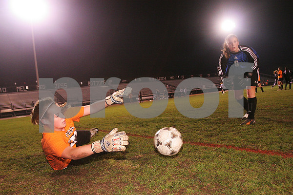 Salem: Katherine Creamer, a freshman goalie at Beverly High School, dives to her right to catch a ball tossed by junior goalie Hayley Lorge during warm ups before the Panthers' away game at Bertram Field in Salem on Monday night. Photo by Matt Viglianti/Salem News Monday, October 27, 2008