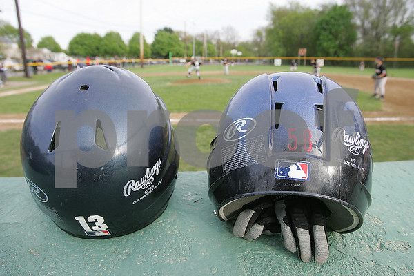 Peabody: Batting helmets rest atop a Peabody Little League dugout at James Street Park during a game on Wednesday. Photo by Matthew Viglianti/Staff Photographer Wednesday, May 6, 2009.