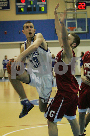 Danvers: Danvers junior captain Mike Warren hangs in the air to absorb contact from a Gloucester defender during the first period of the team's home game on Thursday night. Photo by Matthew Viglianti/Staff Photographer Thursday, February 12, 2009.