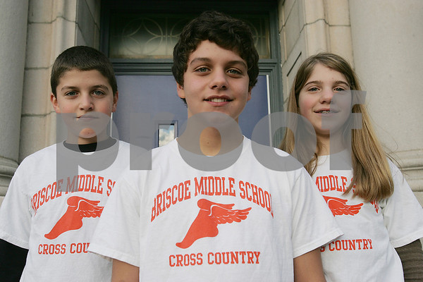 Beverly: Triplets Sam, Alex, and Emily Wheeler, 13, are eigth graders at the Briscoe Middle School in Beverly. All three run cross-country at the school. Photo by Matt Viglianti/Salem News Monday, November 10, 2008