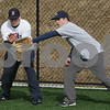 Danvers: St. John's Prep junior Nick Fabrizio, right, reaches in front of senior Chris Carmain to snag a ground ball during tryouts for the baseball team on Monday in Danvers. Photo by Matthew Viglianti/Staff Photographer Monday, March 16, 2009.