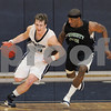 Wenham: Endicott College freshman Danquah Rawlins, right, pursues Aaron Trigg, a Gordon College senior, up the court during the second half of their teams' game in Wenham on Thursday. Photo by Matthew Viglianti/Staff Photographer Thursday, December 3, 2009.