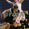 Salem: Peabody captain Marc Lineham looks for an option after dribbling around Salem's Danny Byors during the first quarter of the teams' game at Salem State on Tuesday. Photo by Matt Viglianti/Salem News Tuesday, December 16, 2008